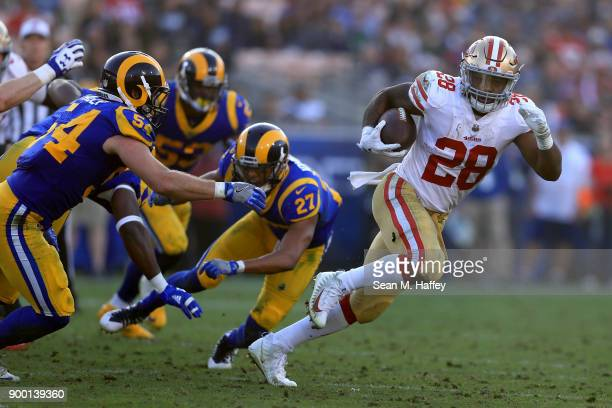 Carlos Hyde of the San Francisco 49ers eludes Bryce Hager Isaiah Johnson and Carlos Thompson of the Los Angeles Rams during the second half of a game...