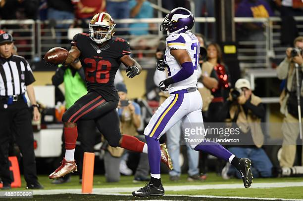 Carlos Hyde of the San Francisco 49ers runs for a touchdown against Robert Blanton of the Minnesota Vikings during their NFL game at Levi's Stadium...