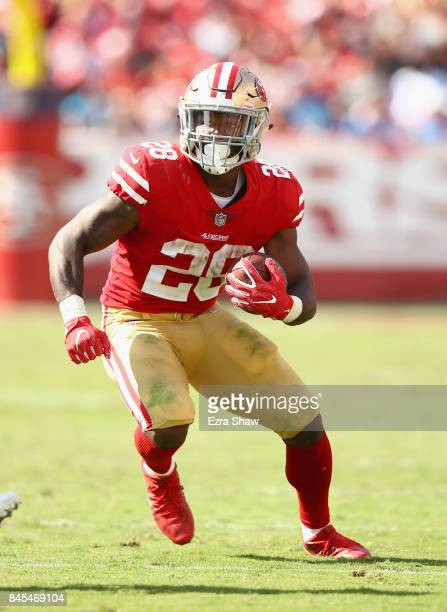 Carlos Hyde of the San Francisco 49ers runs with the ball against the Carolina Panthers at Levi's Stadium on September 10 2017 in Santa Clara...