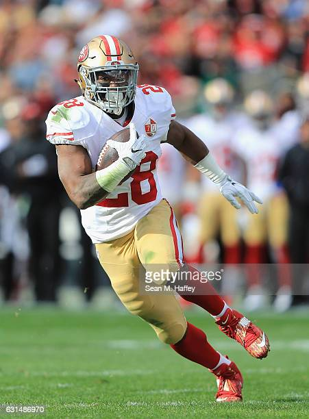 Carlos Hyde of the San Francisco 49ers runs with the ball during the game against the Los Angeles Rams at Los Angeles Memorial Coliseum on December...