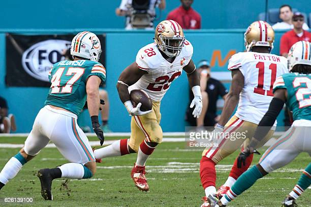 Carlos Hyde of the San Francisco 49ers rushes during the 2nd quarter against the Miami Dolphins at Hard Rock Stadium on November 27 2016 in Miami...