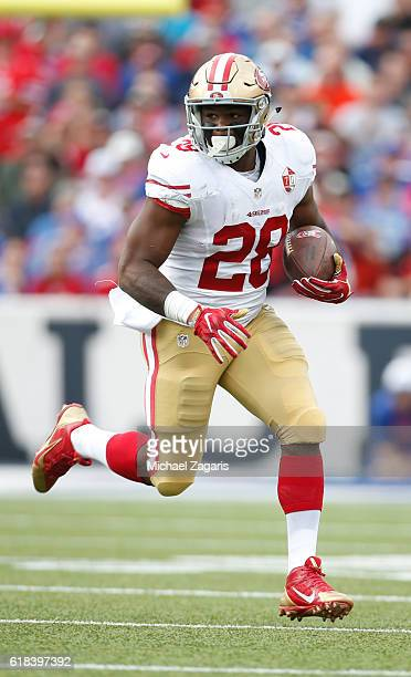 Carlos Hyde of the San Francisco 49ers rushes during the game against the Buffalo Bills at New Era Field on October 16 2016 in Orchard Park New York...