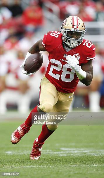Carlos Hyde of the San Francisco 49ers rushes during the game against the New York Jets at Levi Stadium on December 11 2016 in Santa Clara California...