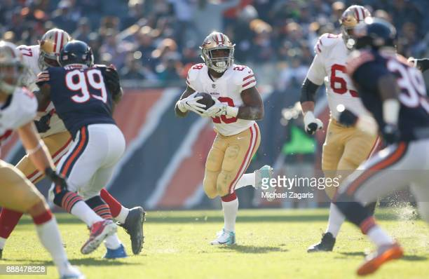 Carlos Hyde of the San Francisco 49ers rushes during the game against the Chicago Bears at Soldier Field on December 3 2017 in Chicago Illinois The...