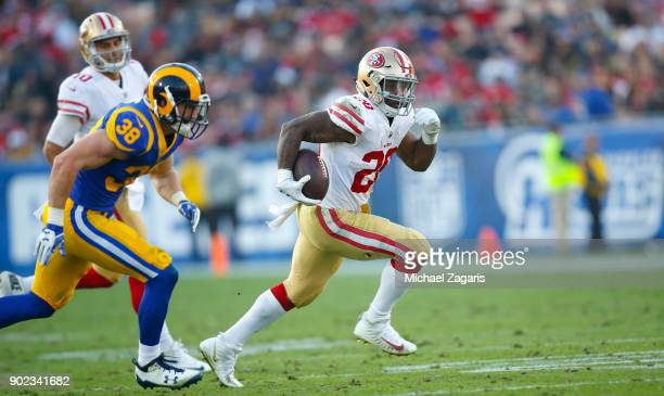 Carlos Hyde of the San Francisco 49ers rushes during the game against the Los Angeles Rams at Los Angeles Memorial Coliseum on December 31 2017 in...