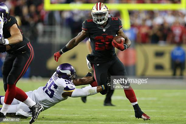 Carlos Hyde of the San Francisco 49ers rushes past Anthony Barr of the Minnesota Vikings during their NFL game at Levi's Stadium on September 14,...