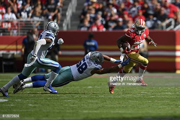 Carlos Hyde of the San Francisco 49ers rushes the ball against the Dallas Cowboys at Levi's Stadium on October 2 2016 in Santa Clara California