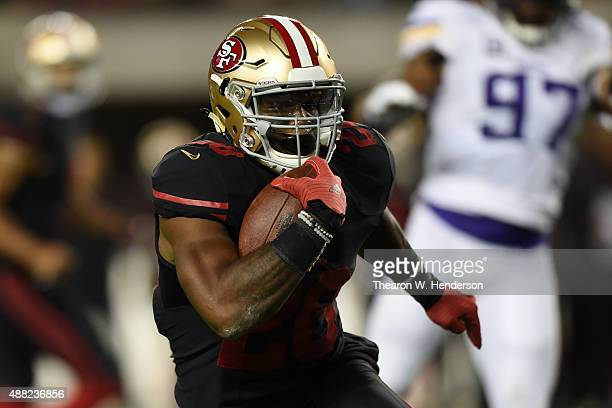 Carlos Hyde of the San Francisco 49ers rushes with the ball against the Minnesota Vikings during their NFL game at Levi's Stadium on September 14...