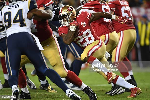 Carlos Hyde of the San Francisco 49ers rushes with the ball against the Los Angeles Rams during their NFL game at Levi's Stadium on September 12 2016...