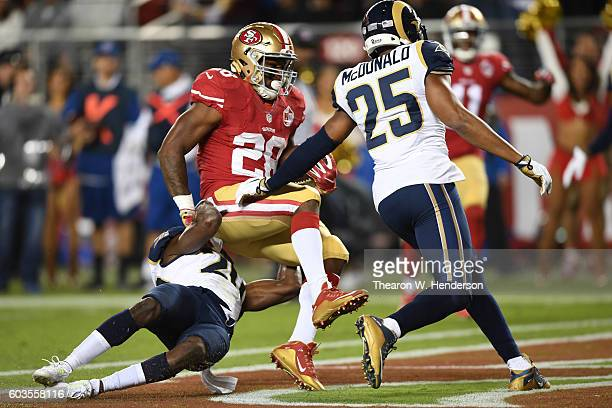 Carlos Hyde of the San Francisco 49ers scores a touchdown on a 11yard run against the Los Angeles Rams during their NFL game at Levi's Stadium on...