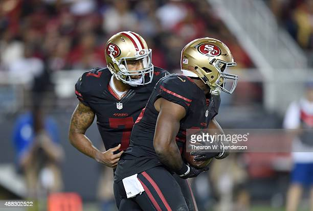 Carlos Hyde of the San Francisco 49ers takes the handoff from Colin Kaepernick against the Minnesota Vikings during their NFL game at Levi's Stadium...