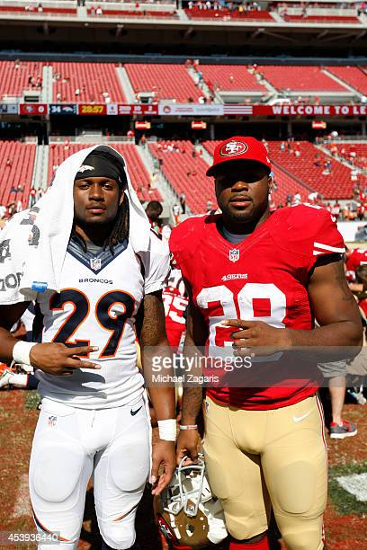 Carlos Hyde of the San Francisco 49ers talks with college teammates Bradley Roby of the Denver Broncos following the game at Levi Stadium on August...