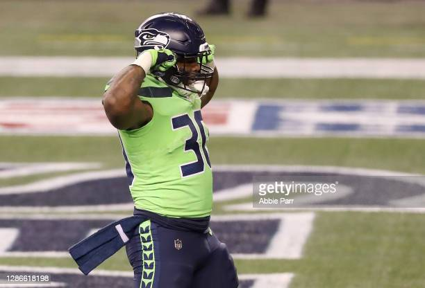 Carlos Hyde of the Seattle Seahawks reacts after he ran in for a touchdown against the Arizona Cardinals in the third quarter at Lumen Field on...