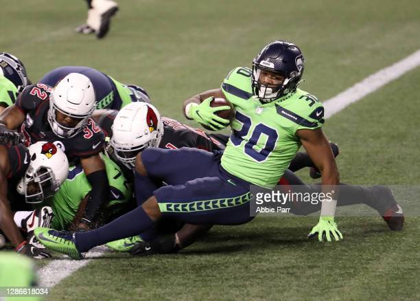 Carlos Hyde of the Seattle Seahawks runs in for a touchdown against the Arizona Cardinals in the third quarter at Lumen Field on November 19, 2020 in...