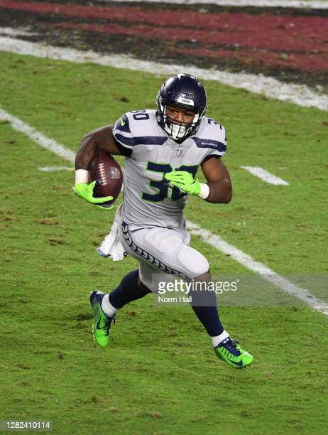 Carlos Hyde of the Seattle Seahawks runs with the ball against the Arizona Cardinals at State Farm Stadium on October 25, 2020 in Glendale, Arizona.
