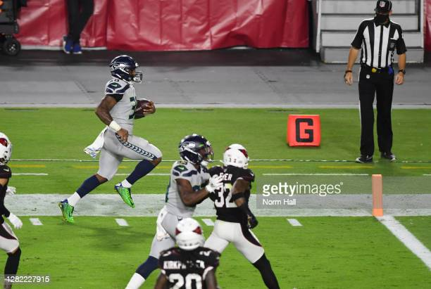 Carlos Hyde of the Seattle Seahawks scores a rushing touchdown during the second quarter against the Arizona Cardinals at State Farm Stadium on...