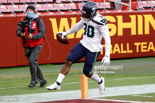 Carlos Hyde of the Seattle Seahawks scores a touchdown against the Washington Football Team at FedExField on December 20, 2020 in Landover, Maryland.