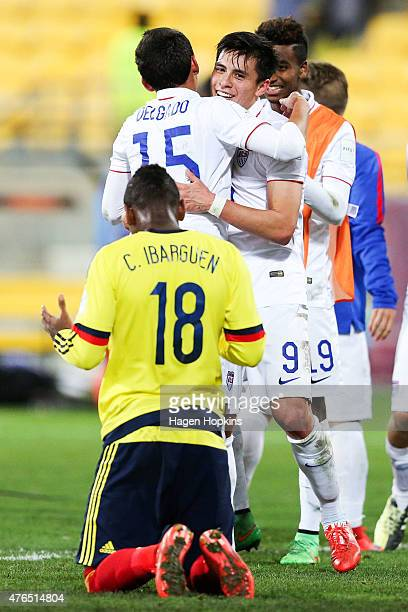 Carlos Ibarguen of Colombia shows his disappointment at the final whistle while Marco Delgado and Rubio Rubin of USA celebrate the win during the...