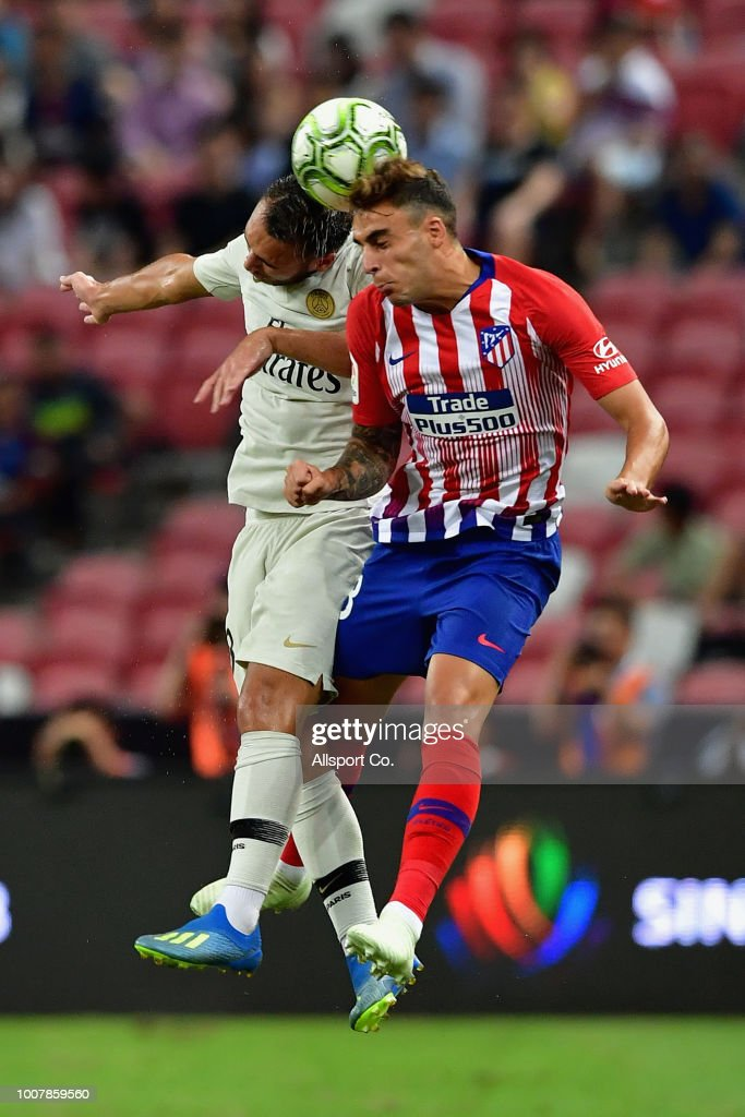 Carlos Issac of Atletico Madrid clashes with Azzedine Toufiqui of Paris Saint Germain during the International Champions Cup match between Paris Saint Germain and Clu b de Atletico Madrid at the National Stadium on July 30, 2018 in Singapore.