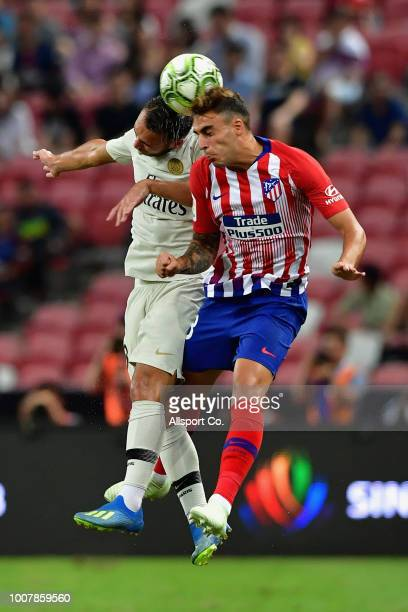 Carlos Issac of Atletico Madrid clashes with Azzedine Toufiqui of Paris Saint Germain during the International Champions Cup match between Paris...