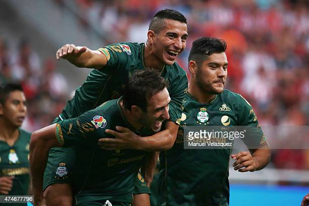 Carlos Izquierdoz celebrates with teammates after scoring the second goal of his team during a semifinal second leg match between Chivas and Santos...