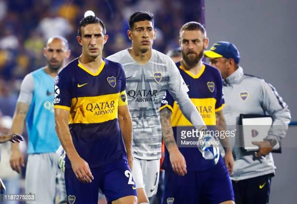 Carlos Izquierdoz Esteban Andrada and Daniele De Rossi of Boca Juniors leave the field after losing a match between Rosario Central and Boca Juniors...