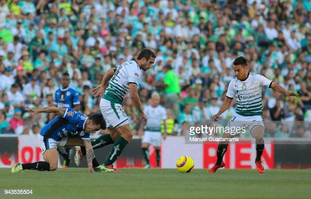 Carlos Izquierdoz Jose Vazquez of Santos fight for the ball with Edson Puch of Queretaro during the 14th round match between Santos Laguna and...
