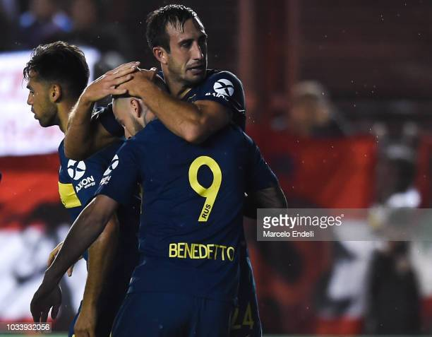Carlos Izquierdoz of Boca Juniors celebrates with teammate Darío Benedetto after scoring the first goal of his team during a match between Argentinos...