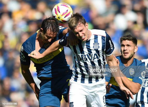 Carlos Izquierdoz of Boca Juniors fights for the ball with Juan Komar of Talleres during a match between Boca Juniors and Talleres as part of...