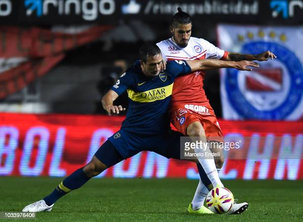 Carlos Izquierdoz of Boca Juniors fights for the ball with Oscar Benitez of Argentinos Juniors during a match between Argentinos Juniors and Boca...