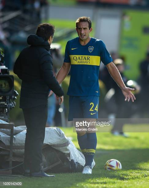 Carlos Izquierdoz of Boca Juniors leaves the field after being injured during a match between Estudiantes and Boca Juniors as part of Superliga...
