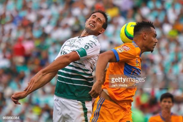 Carlos Izquierdoz of Santos and Timothee Kolodziedjczak of Tigres goes for a header during the quarter finals second leg match between Santos Laguna...