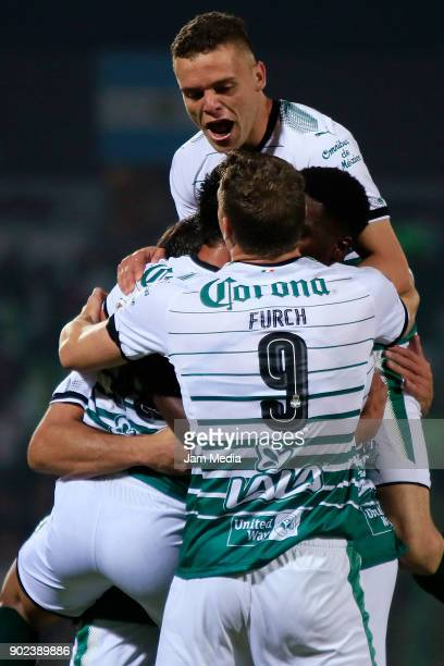 Carlos Izquierdoz of Santos celebrates with teammates after scoring the fourth goal of his team during the first round match between Santos Laguna...
