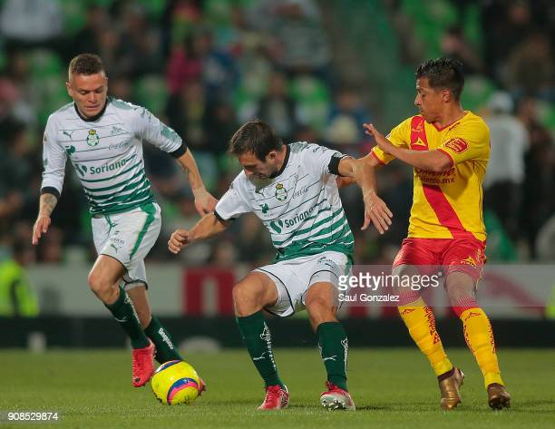 Carlos Izquierdoz of Santos fight for the ball with Angel Sepulveda of Morelia during the 3rd round match between Santos Laguna and Morelia as part...