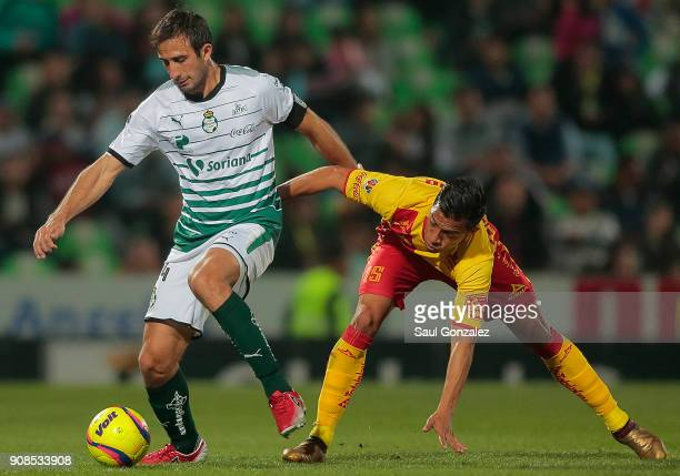 Carlos Izquierdoz of Santos fights for the ball with Angel Sepulveda of Morelia during the 3rd round match between Santos Laguna and Morelia as part...