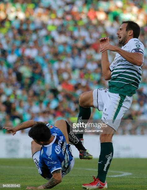 Carlos Izquierdoz of Santos fights for the ball with Edson Puch of Queretaro during the 14th round match between Santos Laguna and Querataro as part...