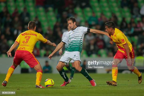 Carlos Izquierdoz of Santos fights for the ball with Gerardo Rodríguez and Angel Sepulveda of Morelia during the 3rd round match between Santos...