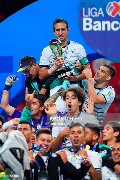 Carlos Izquierdoz of Santos holds the Championship Trophy after the Final second leg match between Toluca and Santos Laguna as part of the Torneo...