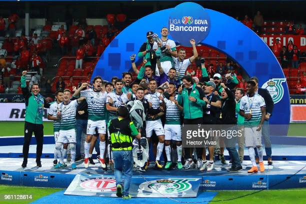 Carlos Izquierdoz of Santos holds the Championship Trophy with teammates after the Final second leg match between Toluca and Santos Laguna as part of...