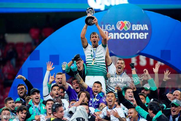 Carlos Izquierdoz of Santos lifts the Championship Trophy after the Final second leg match between Toluca and Santos Laguna as part of the Torneo...