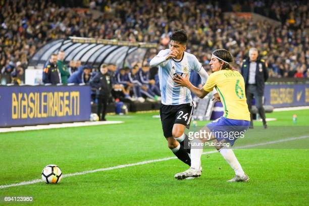 Carlos Joaquin Correa dribbles with the ball past Filipe Luís as Argentina plays Brazil in the Chevrolet Brasil Global Tour on June 09 2017 in...
