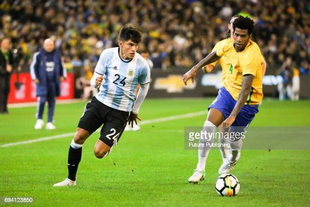 Carlos Joaquin Correa dribbles with the ball past Silva as Argentina plays Brazil in the Chevrolet Brasil Global Tour on June 09 2017 in Melbourne...