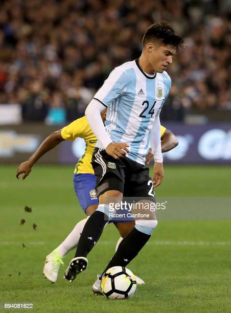 Carlos Joaquin Correa of Argentina controls the ball during the Brazil Global Tour match between Brazil and Argentina at Melbourne Cricket Ground on...