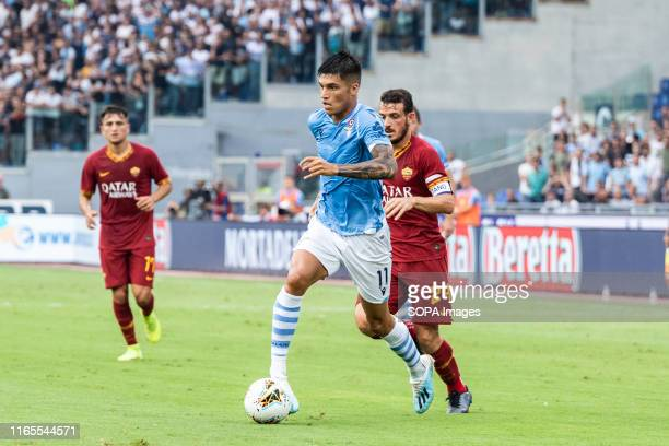 Carlos Joaquin Correa of Lazio in action during the Serie A match between Lazio and AS Roma at Olimpico Stadium
