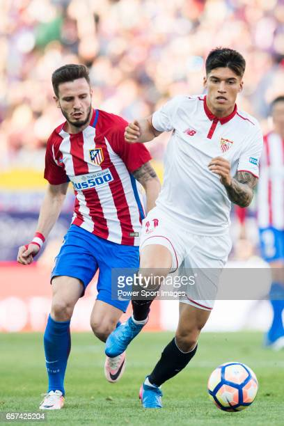 Carlos Joaquin Correa of Sevilla FC battles for the ball with Saul Niguez Esclapez of Atletico de Madrid during their La Liga match between Atletico...