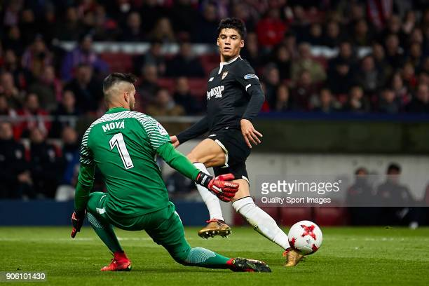 Carlos Joaquin Correa of Sevilla FC shots on goal and Miguel Angel Moya of Atletico de Madrid stops the ball during the Copa del Rey Round of 8 first...