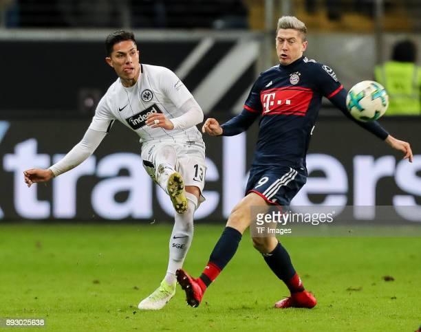 Carlos Joel Salcedo Hernandez of Frankfurt and Robert Lewandowski of Muenchen battle for the ball during the Bundesliga match between Eintracht...