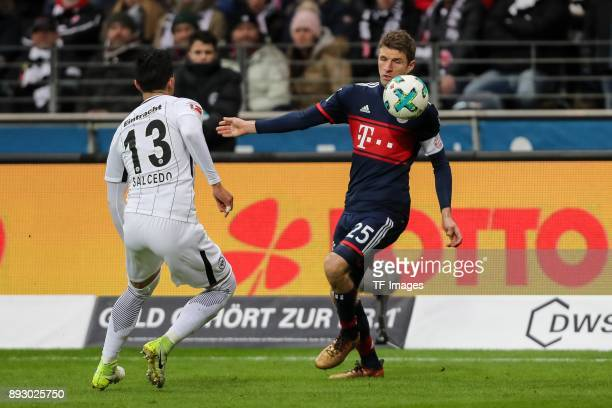 Carlos Joel Salcedo Hernandez of Frankfurt and Thomas Mueller of Muenchen battle for the ball during the Bundesliga match between Eintracht Frankfurt...