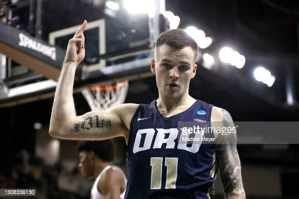 Carlos Jurgens of the Oral Roberts Golden Eagles reacts in the first half against the Florida Gators in the second round game of the 2021 NCAA Men's...