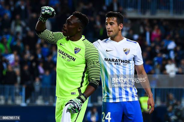 Carlos Kameni and Luis Hernandez of Malaga CF during the La Liga match between Malaga CF and FC Barcelona at La Rosaleda stadium on April 8 2017 in...